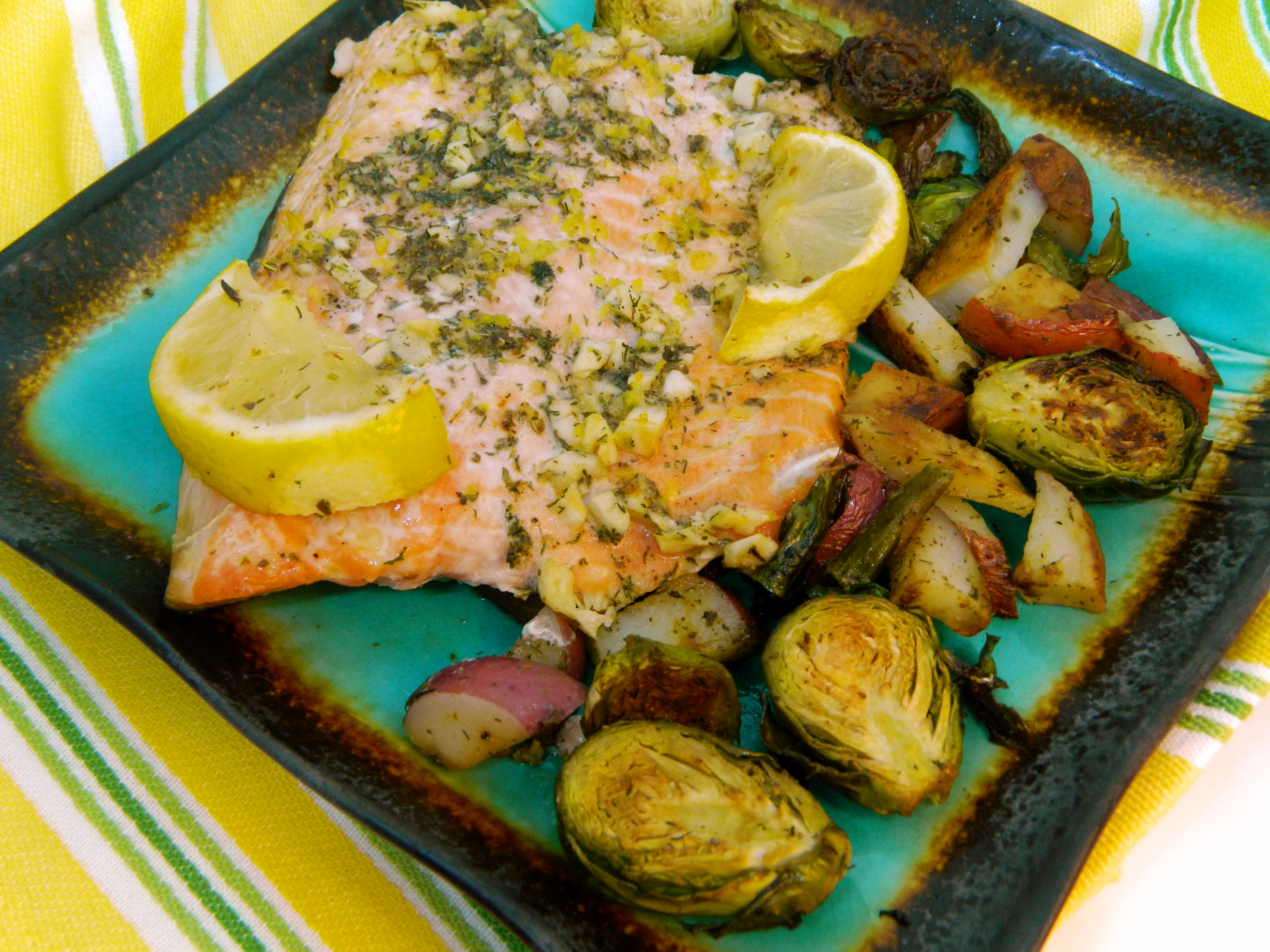 salmon on a green plate with brussel sprouts